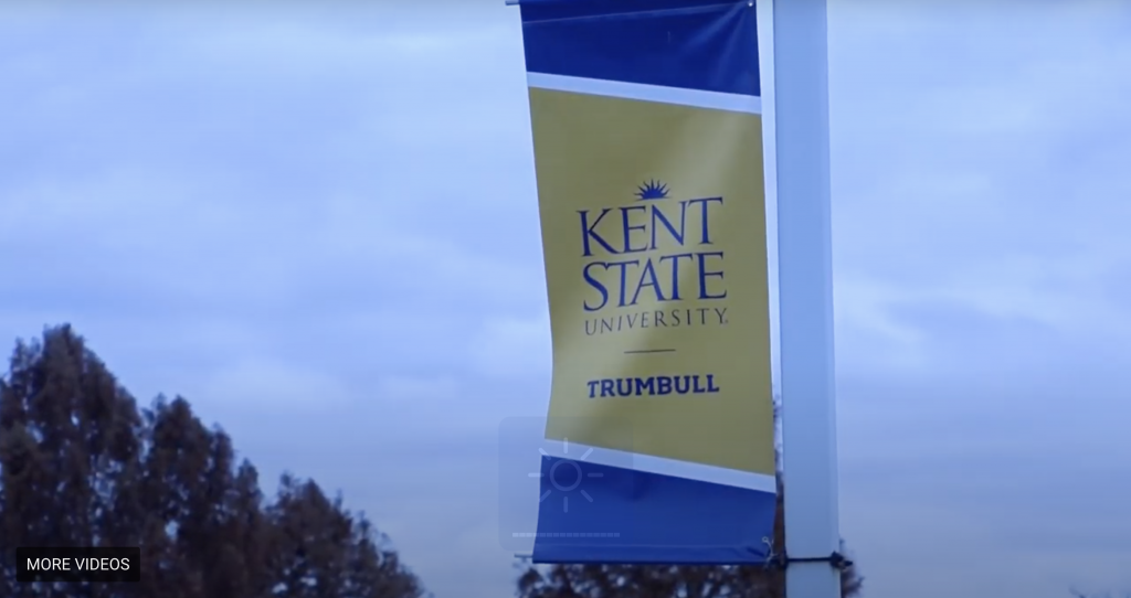 Kent State Trumbull Banner attached to pole on entry road to campus
